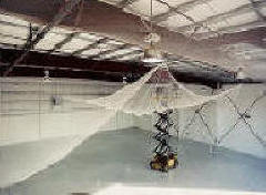Installing net to underside of warehouse ceiling
