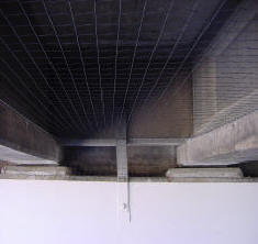 Pigeon control netting to exclude the pigeons from under freeway underpass